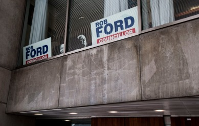 Rob Ford's Councillor signs were put back in his office's window, as the the late former mayor's funeral was held on Wednesday.