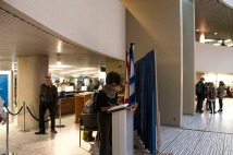 Inside City Hall, Janice Honore signs the guest book, giving her condolences to the Ford family.