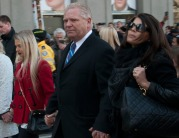 Doug Ford, brother of Rob, walks with family during his brother's funeral procession on Queen Street.
